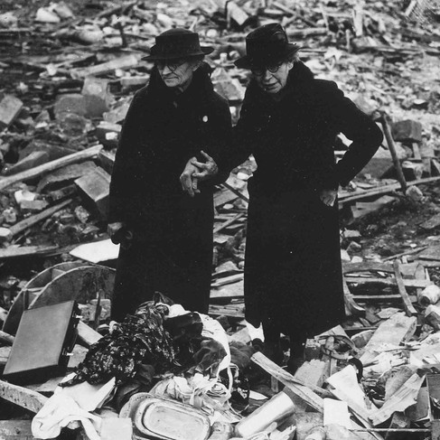 """""""Two bewildered old ladies stand amid the leveled ruins of the almshouse which was home; until Jerry dropped his bombs. Total war knows no bounds. Almshouse bombed February 10, Newbury, Berkshire, England""""  February 11, 1943 Newbury, Berkshire, England, Great Britain Author unknown or not provided © courtesy Franklin D. Roosevelt Library Public Domain Photographs, 1882 - 1962 Collection/ U.S. National Archives and Records Administration"""