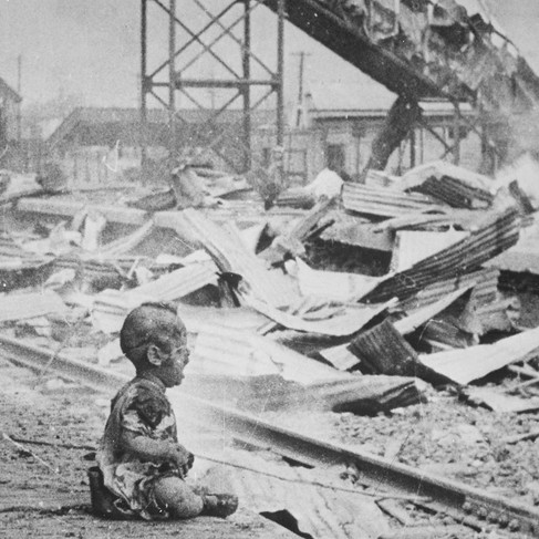 """""""This terrified baby was almost the only human being left alive in Shanghai's South Station after brutal Japanese bombing.""""   August 28, 1937 Shanghai, China Author H. S. Wong (1900–1981) © courtesy U.S. National Archives and Records Administration"""