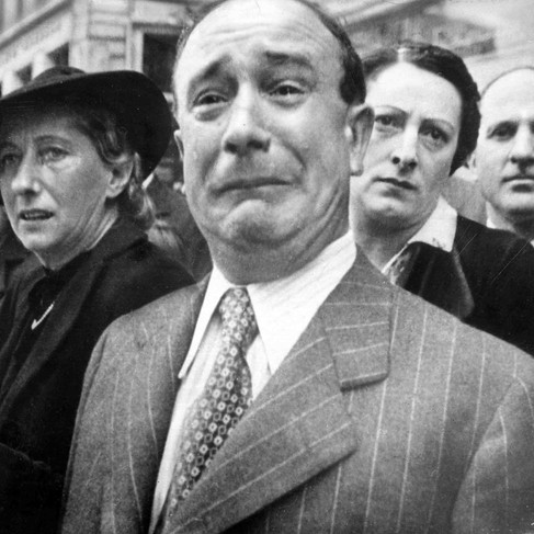"""""""A Frenchman weeps as German soldiers march into the French capital Paris, after the Allied armies had been driven back across France""""  June 14, 1940 Paris, France Author unknown or not provided © courtesy U.S. National Archives and Records Administration"""