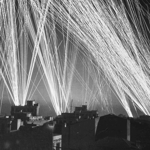 """""""Ack-Ack fire during an air raid on Algiers, by the Nazis""""  1943 Algiers, Algeria  Author unknown or not provided © courtesy U.S. National Archives and Records Administration"""