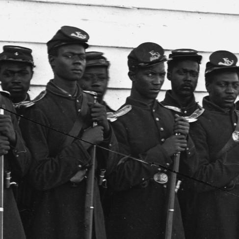 Uomini della Compagnia E, 4° corpo di Fanteria di Colore degli Stati Uniti.