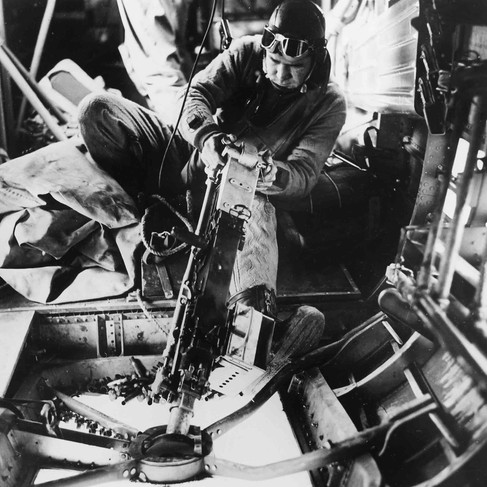 """""""United States Army Air Force gunner Sgt. William Watts of Alexandria, La. fires machine gun on enemy during aerial fight with German planes somewhere in the European theatre""""  ca. 1942 Author Unknown or not provided © courtesy Franklin D. Roosevelt Library Public Domain Photographs, 1882 - 1962 Collection/ U.S. National Archives and Records Administration"""