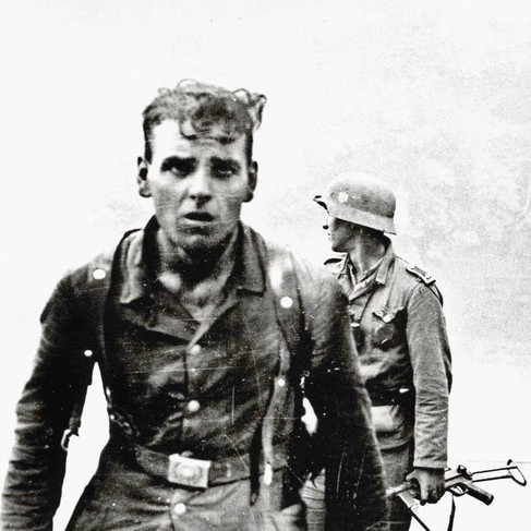 """""""German soldiers after a street fight"""". In his hand he has a Luger pistol and a hatchet used for hand-to-hand combat.   January – February, 1943  Novorossiysk, USSR (Russia) Author unknown  Archive unknown Source Reddit.com"""