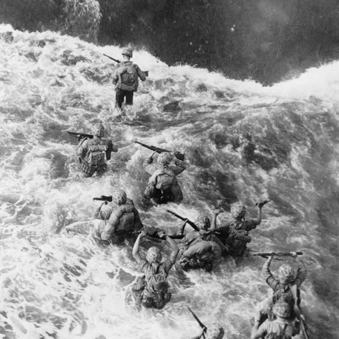 """""""The Marines land - Marines hit three feet of water as they leave their LST to take the beach at Cape Gloucester""""  December 26,  1943 Cape Gloucester, Papua New Guinea  Author Unknown or not provided © courtesy Defense Dept. photo (Marine Corps) / Library of Congress"""