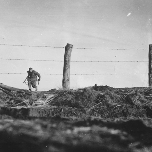 """""""Infantryman goes out on a one-man sortie, covered by a buddy in the background. 82nd Airborne Division.""""  December 24, 1944 Bra, Belgium Author unknown or not provided © courtesy U.S. National Archives and Records Administration"""