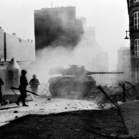 """""""US tank destroyer M36 fires its 90mm gun point-blank at a Nazi pillbox emplacement to clear a path through a side street in Brest, France""""   (Official U.S. Army photograph)  September 1944 Brest, France Author unknown or not provided © courtesy Joseph J. Spagnola collection / Library of Congress"""