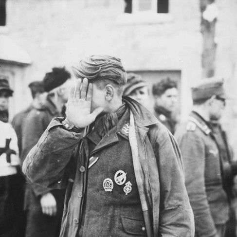 """""""A German prisoner captured by the 16th Infantry Regiment""""   January 15, 1944 Near Weywertz. Belgium Author unknown or not provided © courtesy U.S. National Archives and Records Administration"""