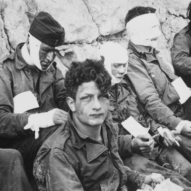 """American Assault Troops of the 16th Infantry Regiment, Injured While Storming Omaha Beach, Wait by the Chalk Cliffs for Evacuation to a Field Hospital for Further Medical Treatment"""
