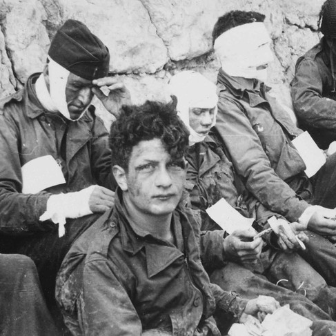 """""""American Assault Troops of the 16th Infantry Regiment, Injured While Storming Omaha Beach, Wait by the Chalk Cliffs for Evacuation to a Field Hospital for Further Medical Treatment"""""""
