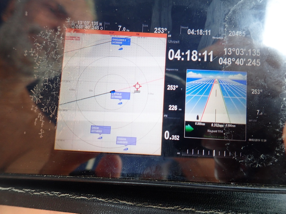 photo of chart plotter with Angelo reflected