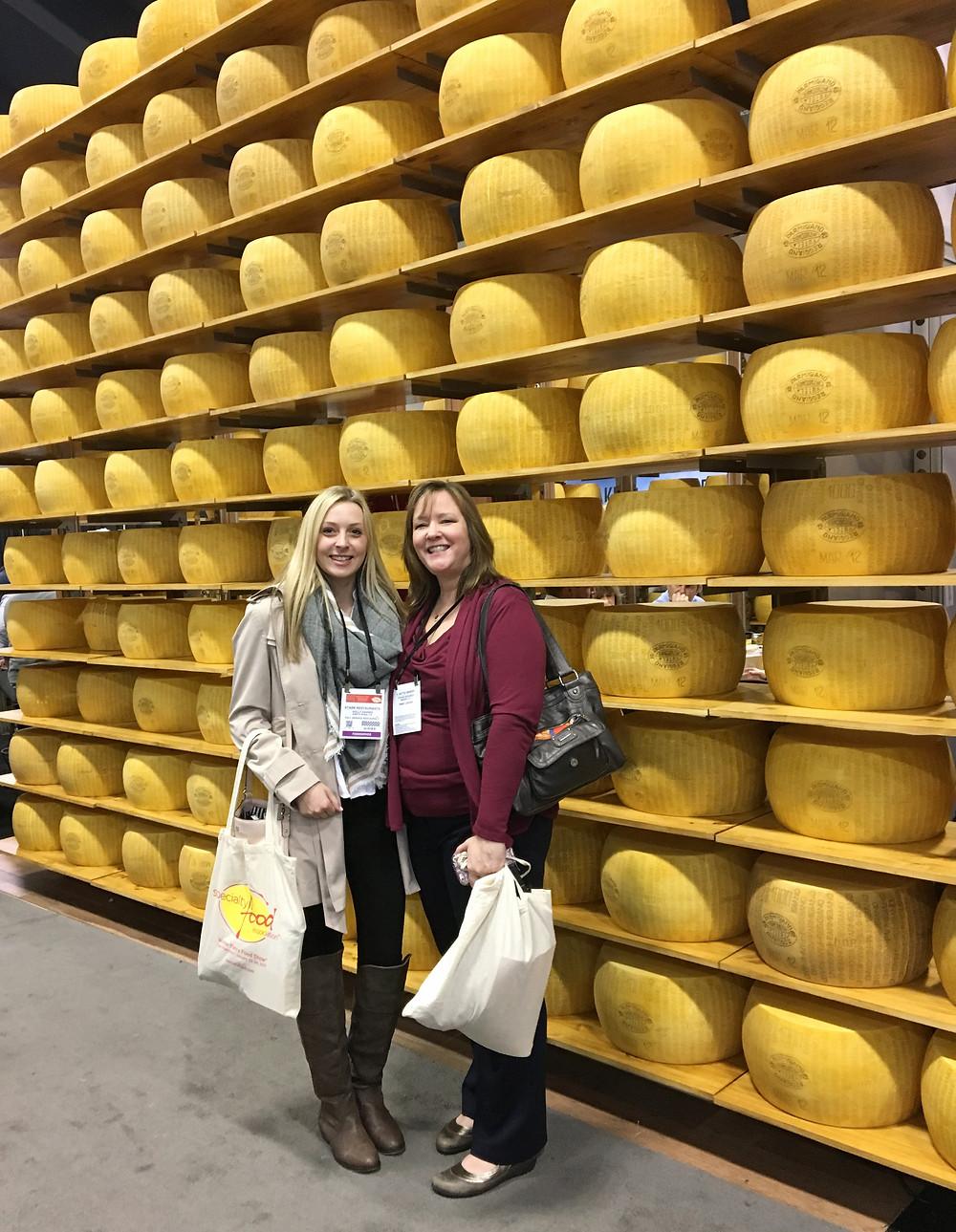 Ali & Tyffani with parmesan-reggiano cheese wall