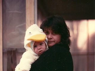 Yoni in duck suit with Ora.jpg