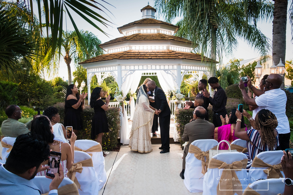 Priya and Henry wedding portraits after their ceremony at The Little Wedding Chapel in Eustis, Florida