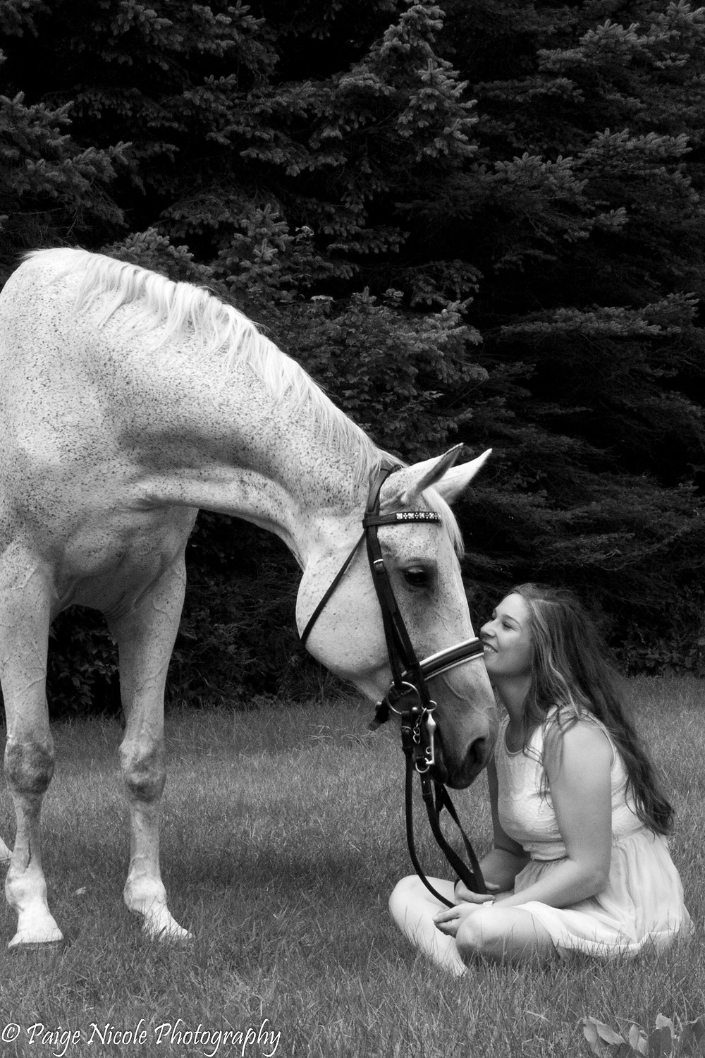 Tara Mason and her pride and joy Anny enjoying the grass and peace of a summer day