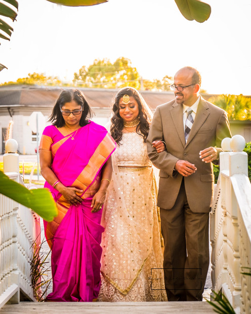 Priya and Henry wedding ceremony her parents walking her down the aisle at The Little Wedding Chapel in Eustis, Florida