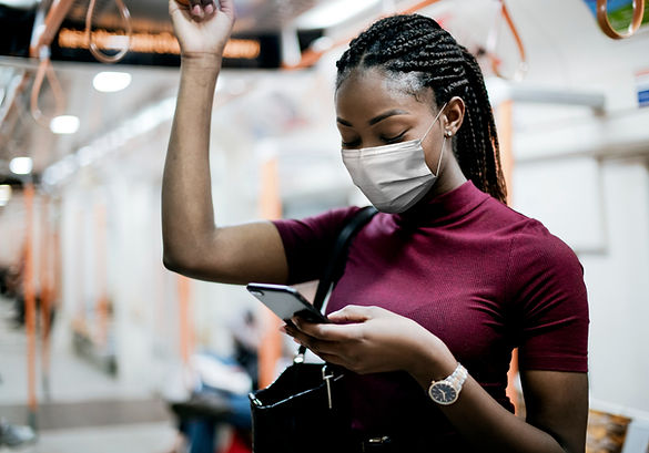 african-american-woman-wearing-mask-bus-while-using-public-transportation-new-normal.jpg