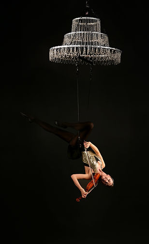 Aerial violinist playing upside down