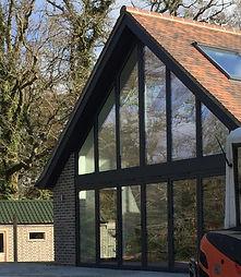 Full height glass gable wall modern kitchen