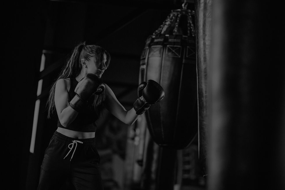 young-woman-boxer-training-gym_edited.jpg