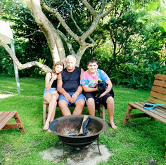 Michelle Goffe Family around Fire pit.jp