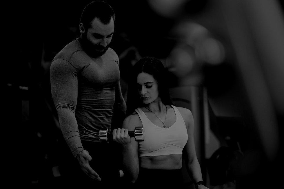 woman-gym-with-coach_edited.jpg