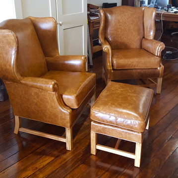 Stunning Leather Wing-Backed Chairs and Footstool