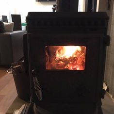 Karen Woodbridge Fireplace in Cabin.jpeg