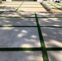 Installation of Artificial turf between slabs