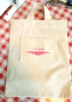 Embroidered bag with handles