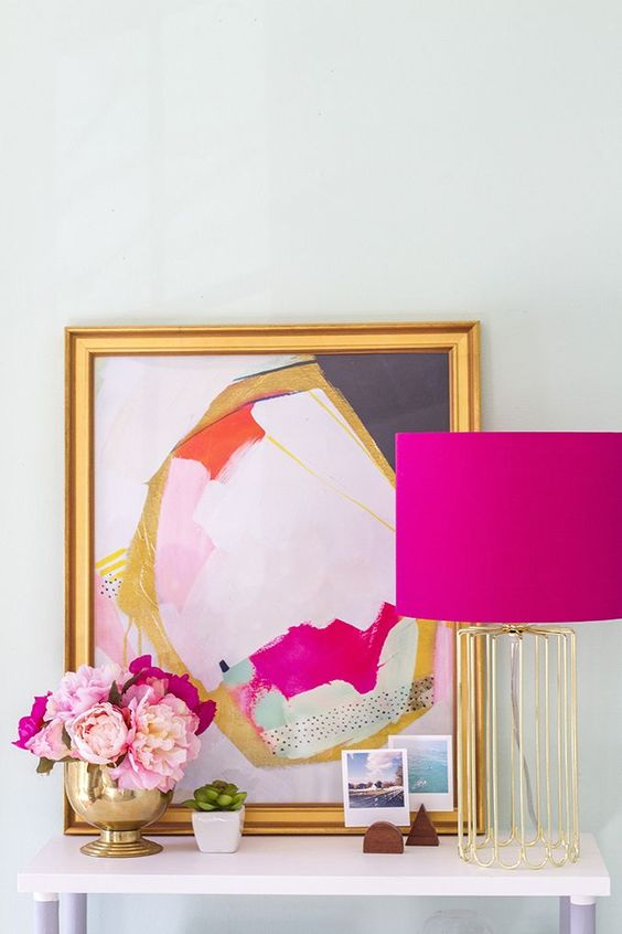 Using color accents such as picture frames, mirrors, art and lamps. Tip: save by rearranging accent pieces you currently have in your home.