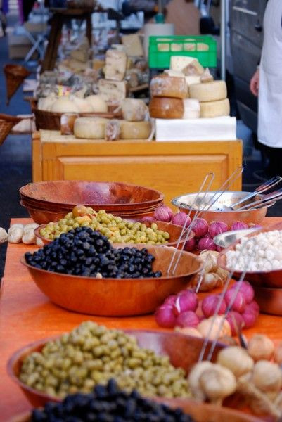 Olives and cheese stand on farmers market in Forcalquier, South of France