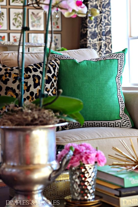 Spice up pillows on your couch by replacing them with bright colors. For a more calmer approach use white and neutral colors.