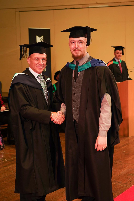 Graduation certificate presentation photography