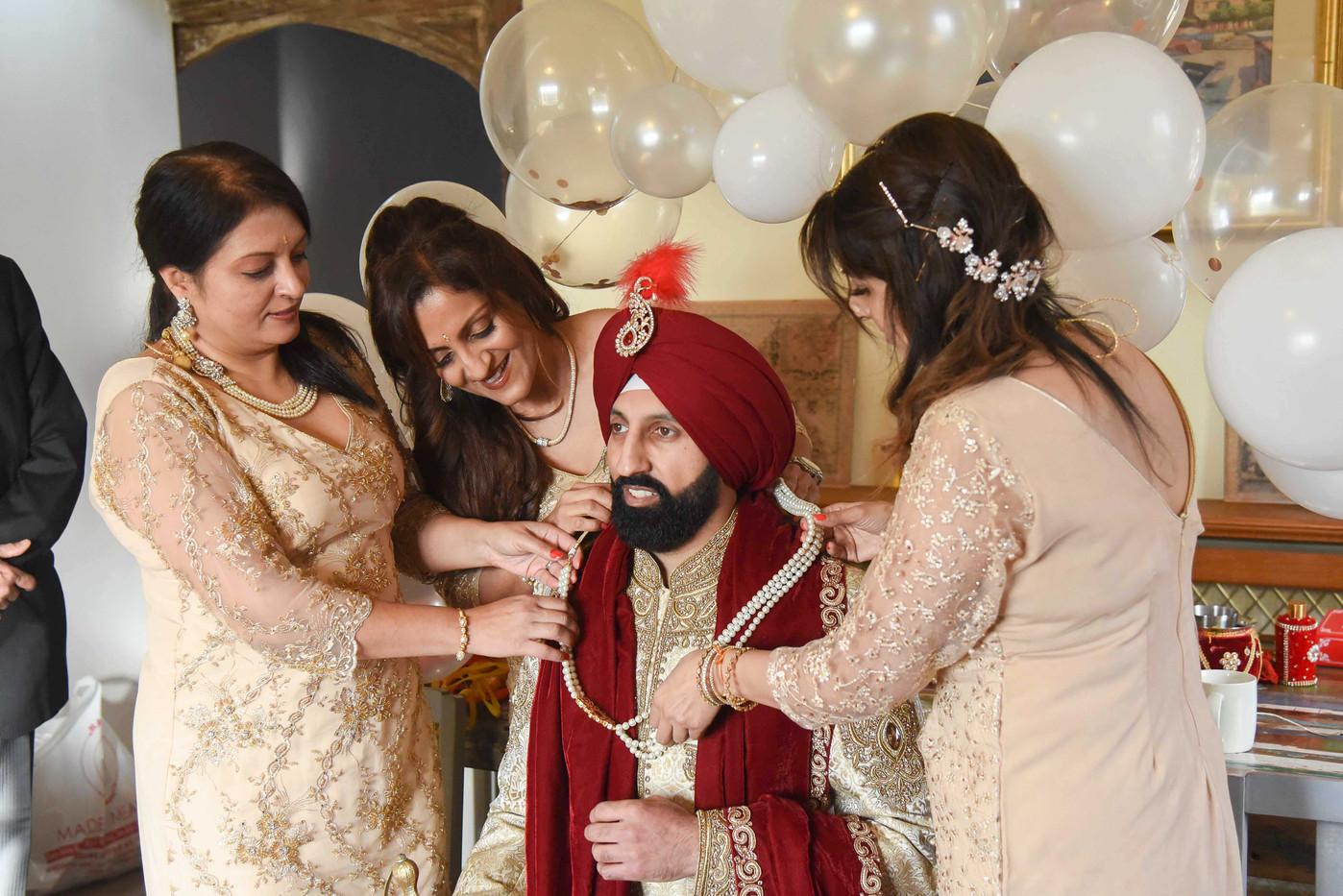 groom-at-indian-wedding-sisters.jpg