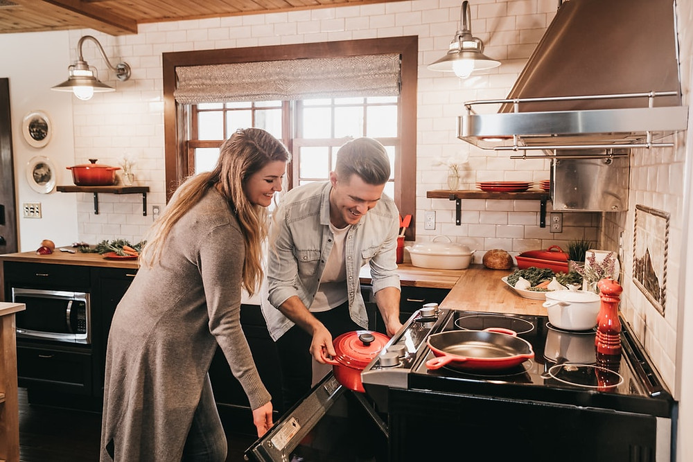 man and woman cooking together in a kitchen