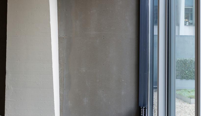 Panneaux bois-ciment CETRIS BASIC, parement intérieur et aménagement de bureaux effet béton. Style industriel.
