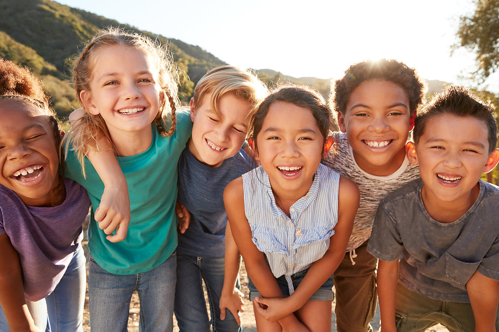 Portrait Of Multi-Cultural Children Hanging Out With Friends In The Countryside Together.j