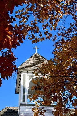 Church steeple with autumn leaves.jpg