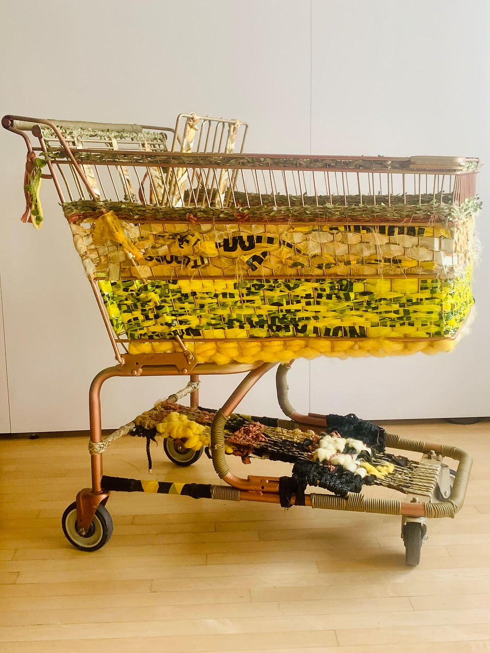 Rose gold Shoping cart woven with various yarns and caution tape