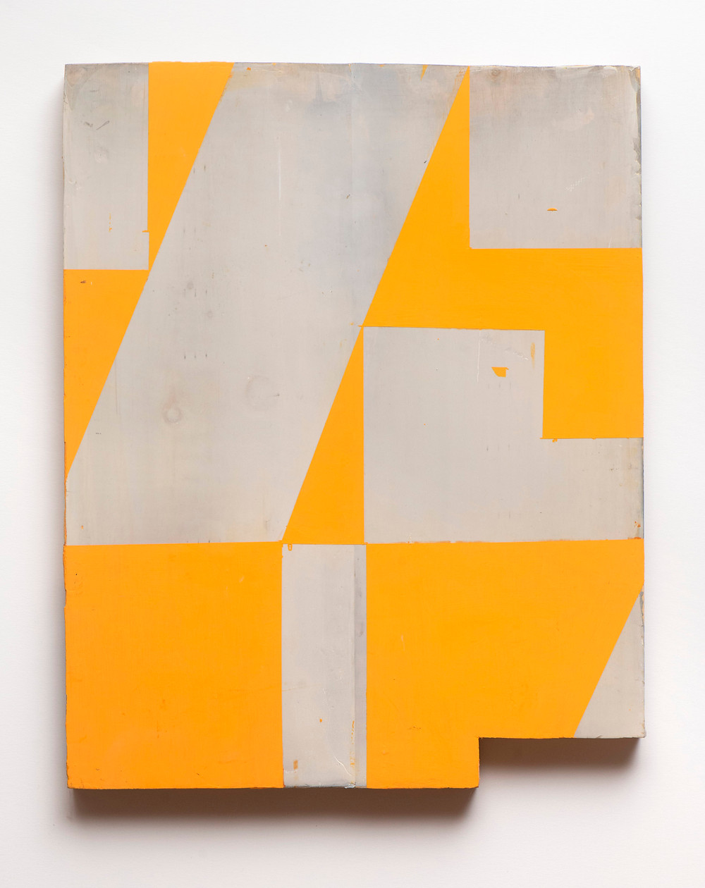 A geometric painting on wood with alternating angles of yellow-orange and white with a broken edged perimeter.