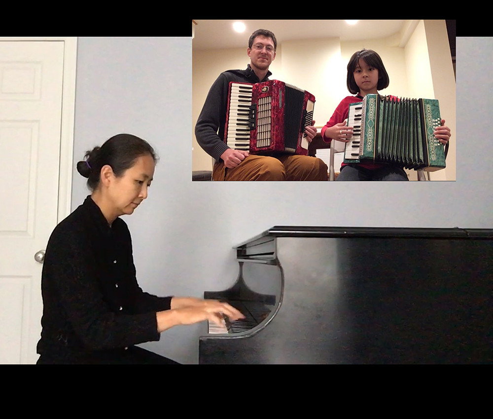 Asian woman playing piano with an inset of a man and young girl playing the accordian