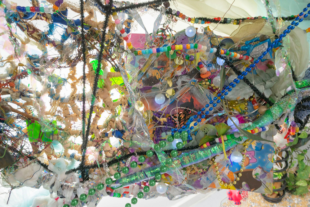 Detail of 'Gypsy Koombyeyah' Installation by Maggie Ens - Colorful installation of beads, wire, toys and other found materials combined into a hanging chaotic net or web