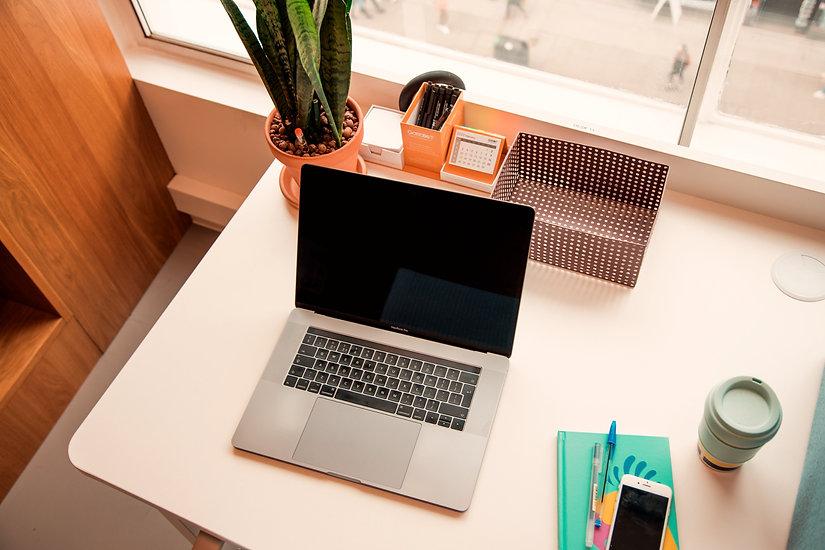 macbook pro on white table_edited.jpg