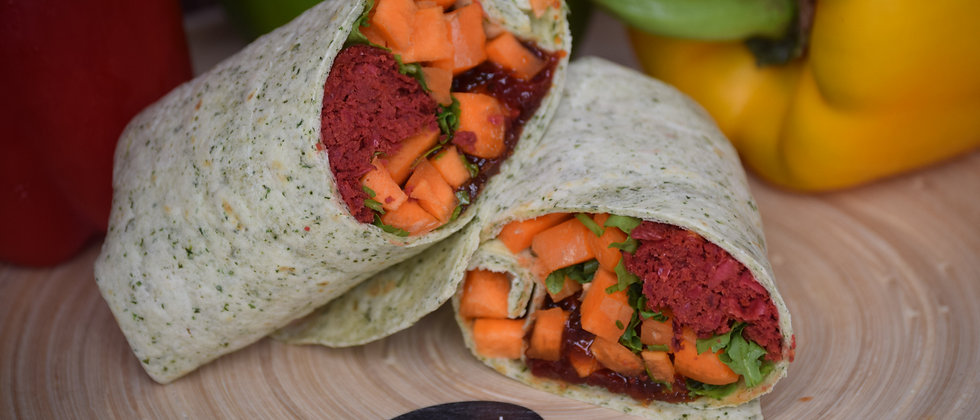 Beetroot Falafel, Carrot and Rocket with Chilli Jam in a Spinach Wrap Served Hot