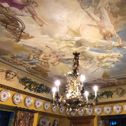 Ceiling painting of horses on canvas.