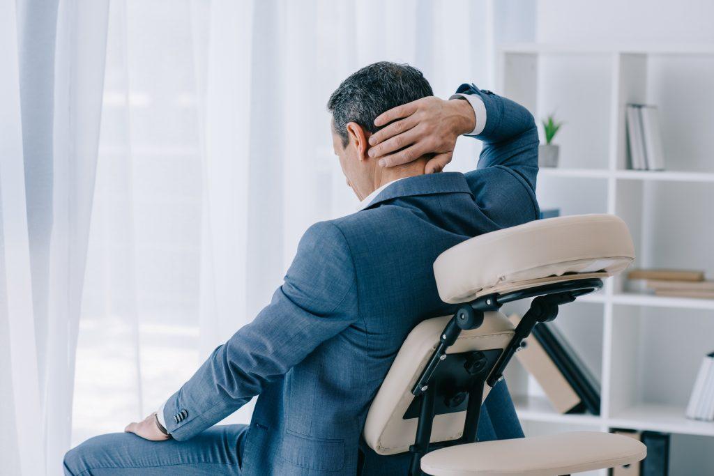 business man being massaged.jpg
