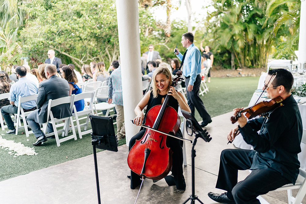String duo performing live music at a wedding ceremony in Bradenton, FL at Mixon Fruit Farms