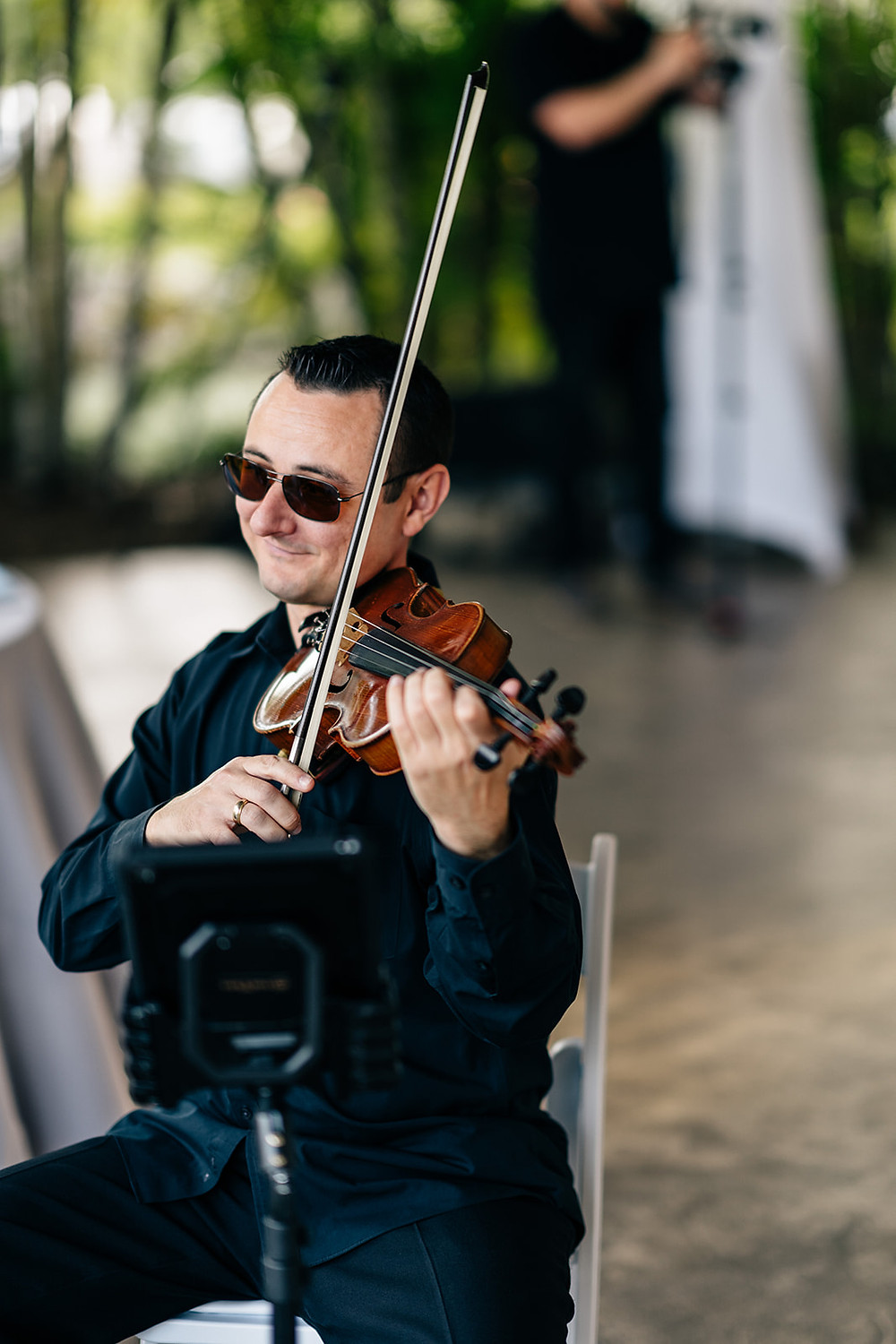 Violinist performing live music for a wedding cocktail hour in Florida
