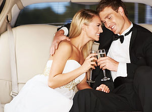 Bride and Groom in Weddin Limo