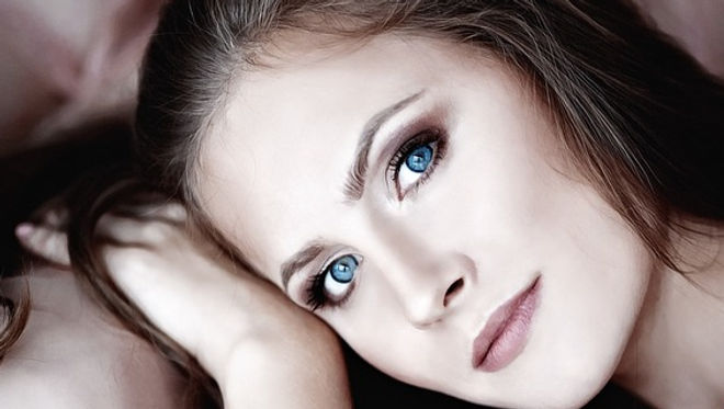 An attractive woman wearing blue contacts